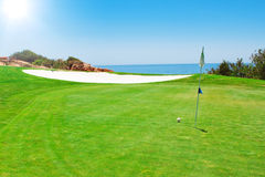 Golf green field on the background of the sea. Royalty Free Stock Photos