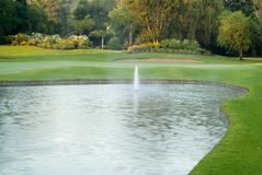 Golf green and fountain Stock Image