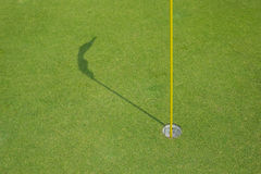 Golf green with hole and flag Royalty Free Stock Images