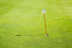 Golf green hole one. View of the hole number one of a green of glof Royalty Free Stock Photo