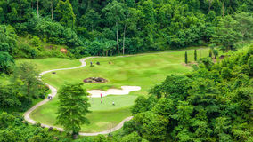 Golf green at park mountain on daylight Royalty Free Stock Image