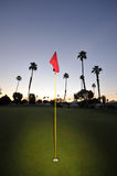 Golf green with pin, flag and fairway Royalty Free Stock Image
