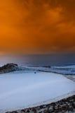 Golf green with winter orange sunset sky Stock Image