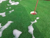 Golf green in winter with snow. Snow on golf green Royalty Free Stock Image