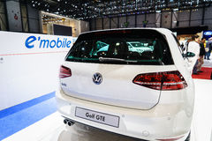 Golf GTE electric, Motor Show Geneva 2015. Futuristic electric concept car charging unveiled by Volkswagen at the 85th International Geneva Motor Show in stock image