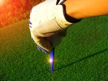 Golf equipment, check the neatness of the iron, put the golf on the red wood floor. stock image