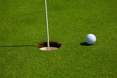 Golf hole. Golf ball in a course and hole Stock Image