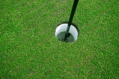 Golf hole. Close-up of a golf hole royalty free stock photo