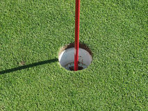 Golf hole. With pin Stock Photo