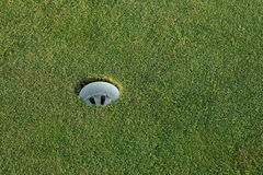 Golf hole. On green grass royalty free stock photo