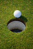 Golf hole. Detail of Golf ball and hole Royalty Free Stock Photography