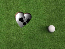 Golf Hole. A golf hole shaped like a heart; metaphorical image for all golf enthusiasts royalty free stock photography