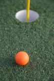 Golf Hole. Close up of a pin and cup on a golf hole Royalty Free Stock Photo