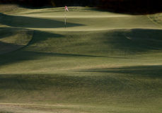 Golf hole. In the desert at dusk Stock Images