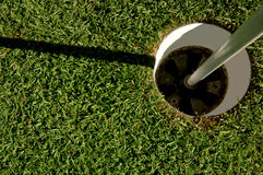 Golf Hole. Looking down into a golf  cup on a putting green. 12MP camera Royalty Free Stock Image