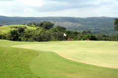 Golf hole. A view of the green on a scenic hill country golf course Royalty Free Stock Images