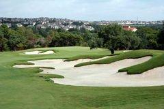 Golf hole. A view of the green on a scenic hill country golf course Stock Photos