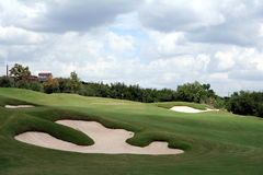 Golf hole. A view of the green on a scenic hill country golf course Stock Image