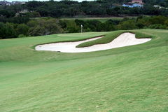 Golf hole. A view of the green on a scenic hill country golf course Royalty Free Stock Photo