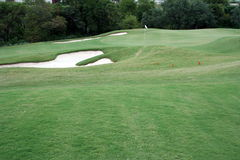 Golf hole. A view of the green on a scenic hill country golf course Stock Photography
