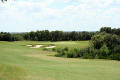 Golf hole. A view of the green on a scenic hill country golf course Royalty Free Stock Image