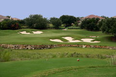 Golf hole. A view of the green on a scenic hill country golf course Stock Photo