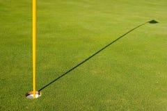 Golf Hole. With flag shadow Stock Photos