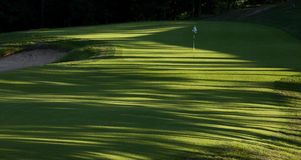 Golf Hole 8h. Dramatic golf hole late in the day with lots of shadows stock photography