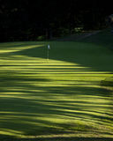 Golf Hole 8V. Golf hole late on a Summer afternoon with lots of shadows stock photos
