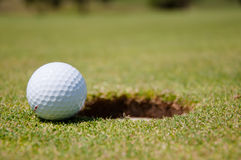 Golf hole with ball Stock Image