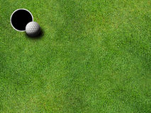 Golf hole and ball. Overhead view of golf ball and hole royalty free stock photography