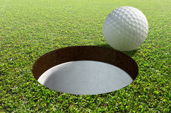 Golf Hole With Ball Approaching Royalty Free Stock Photo