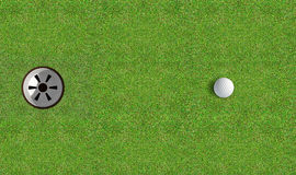 Golf Hole With Ball Approaching Royalty Free Stock Photography