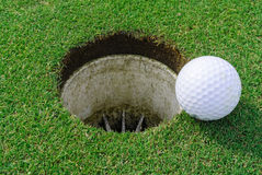 Golf hole and ball Royalty Free Stock Photo