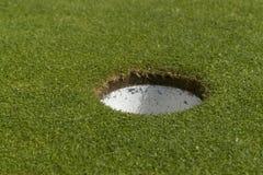 Golf hole closeup Stock Photo