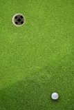 Golf hole on a field Royalty Free Stock Photography