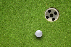 Golf hole on a field Royalty Free Stock Images