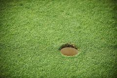 Golf hole on a field Stock Photography