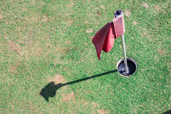 Golf hole with flag Royalty Free Stock Photography