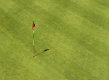 Golf hole with flag from above Stock Photo