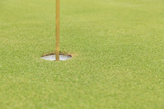 Golf hole and flag Stock Photo