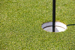 Golf hole and flag Royalty Free Stock Photos