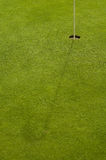 Golf hole and grass Stock Photography