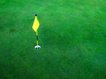 Golf Hole on Green Grass. Flag and hole for golf on green grass Royalty Free Stock Photo