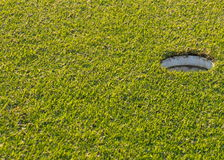 Golf hole. On the green grass Stock Image
