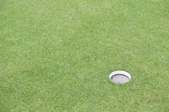 Golf hole on green grass field. For background Stock Photos