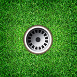 Golf hole on green grass of golf course. Royalty Free Stock Image