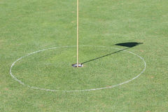 Golf hole on green grass Stock Photography