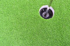 Golf hole with green grass. Royalty Free Stock Photo