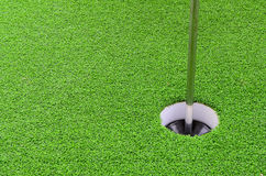 Golf hole with green grass. Royalty Free Stock Images